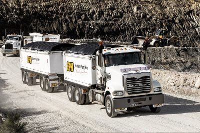 Truck & Quad Dog hauling heavy materials in Melbourne